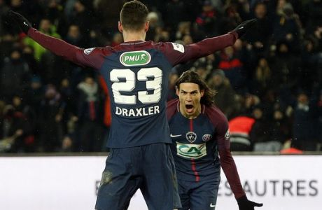 PSG's Edinson Cavani, right, celebrates with teammate Julian Draxler after scoring his side's third goal during the French Cup soccer match between Paris Saint-Germain and Marseille at the Parc des Princes Stadium, in Paris, France, Wednesday, Feb. 28, 2018. (AP Photo/Thibault Camus)