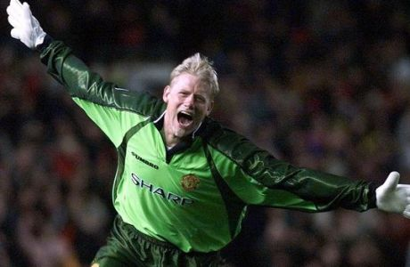 Manchester United's goalkeeper Peter Schmeichel wheels around in delight after teammate Ryan Giggs scored the equalizer against Juventus during their semi-final of the European Champions Cup at Manchester's Old Trafford stadium Wednesday, April 7, 1999.  The match ended in a 1-1 draw afrer Giggs scored in injury time. (AP Photo/Dave Caulkin)