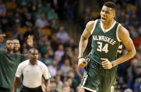 Milwaukee Bucks forward Giannis Antetokounmpo (34) reacts after hitting a three-point shot during the first half of an NBA basketball game against the Boston Celtics, Wednesday, March 29, 2017, in Boston. (AP Photo/Mary Schwalm)