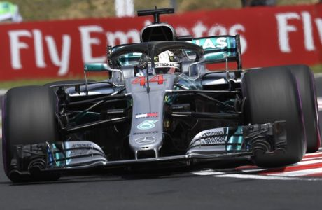 British Formula One driver Lewis Hamilton of Mercedes AMG GP in action during the third free practice session of the Hungarian Formula One Grand Prix at the Hungaroring circuit, in Mogyorod, northeast of Budapest, Hungary, Saturday, July 28, 2018. The Hungarian Formula One Grand Prix will take place on Sunday. (Tamas Kovacs/MTI via AP)