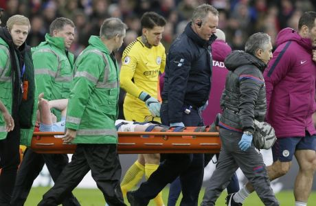 Manchester City's Kevin De Bruyne is carried off injured during the English Premier League soccer match between Crystal Palace and Manchester City at Selhurst Park in London, Sunday Dec. 31, 2017. (AP Photo/Tim Ireland)