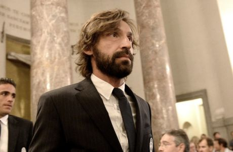 Juventus' Andrea Pirlo arrives in  the Church of the Great Mother of God in Turin, Italy, Friday, May 29, 2015, to take part in a commemoration mass marking the 30th anniversary of the Heysel stadium tragedy where 39 people died during fan violence at the 1985 European Cup final between Liverpool and Juventus in Brussels.  (AP Photo/Massimo Pinca)