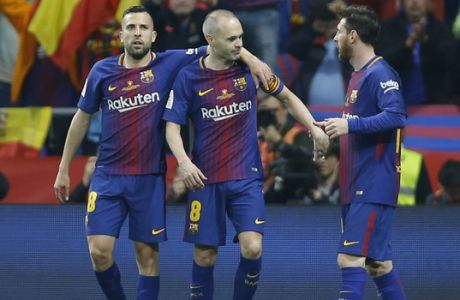 Barcelona's Andres Iniesta, centre, celebrates with his teammates Jordi Alba, left, and Lionel Messi after scoring against Sevilla during the Copa del Rey final soccer match between Barcelona and Sevilla at the Wanda Metropolitano stadium in Madrid, Spain, Saturday, April 21, 2018. (AP Photo/Francisco Seco)