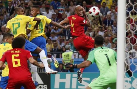 Brazil's Fernandinho, top left, scores an own goal, the first for Belgium side's during the quarterfinal match between Brazil and Belgium at the 2018 soccer World Cup in the Kazan Arena, in Kazan, Russia, Friday, July 6, 2018. (AP Photo/Frank Augstein)