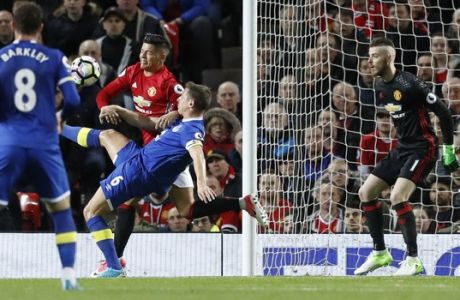 Everton's Phil Jagielka, 3rd left, in action to score his sides opening goal of the game against Manchester United during their English Premier League soccer match between Manchester United and Everton at Old Trafford in Manchester, England, Tuesday April 4, 2017. (Martin Rickett/PA via AP)