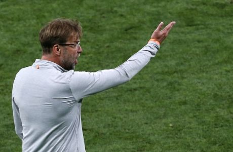 Liverpool coach Jurgen Klopp gives instructions to his players during the Champions League Final soccer match between Real Madrid and Liverpool at the Olimpiyskiy Stadium in Kiev, Ukraine, Saturday, May 26, 2018. (AP Photo/Darko Vojinovic)
