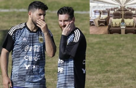 Argentina's Lionel Messi, right, and Sergio Aguero talk during a training session in Buenos Aires, Argentina, Sunday, May 27, 2018. Argentina will face Haiti on May 29 in an international friendly soccer match ahead of the FIFA Russia World Cup. (AP Photo/Natacha Pisarenko)