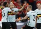 Belgium's Radja Nainggolan, second from left, celebrates after scoring the opening goal during the Euro 2016 quarterfinal soccer match between Wales and Belgium, at the Pierre Mauroy stadium in Villeneuve d'Ascq, near Lille, France, Friday, July 1, 2016. (AP Photo/Frank Augstein)