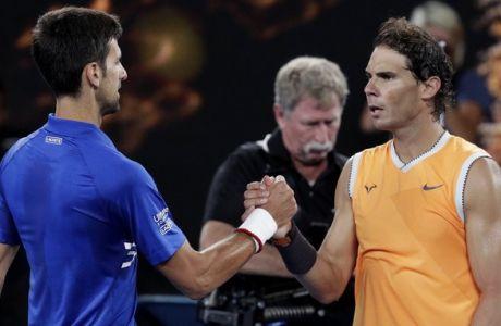 Spain's Rafael Nadal, right, congratulates Serbia's Novak Djokovic after Djokovic won the men's singles final at the Australian Open tennis championships in Melbourne, Australia, Sunday, Jan. 27, 2019. (AP Photo/Aaron Favila)