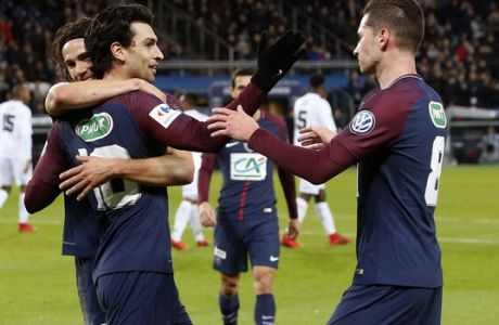 PSG's Javier Pastore, center, celebrates with Edinson Cavani, left, and Julian Draxler, right, after scoring his side's third goal, during the French Cup soccer match, between Paris Saint-Germain and Guingamp at the Parc des Princes Stadium, in Paris, France, Wednesday, Jan. 24, 2018. (AP Photo/Thibault Camus)