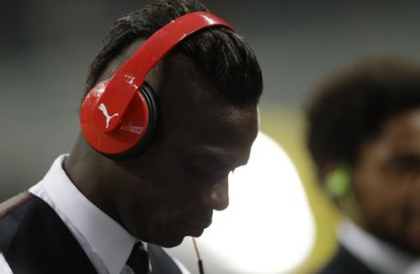AC Milan's Mario Balotelli looks on prior to the start of a Serie A soccer match between Inter Milan and AC Milan, at the San Siro stadium in Milan, Italy, Sunday, Sept.13, 2015. (AP Photo/Luca Bruno)