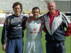 Belgian soccer player Jean-Marc Bosman, centre, poses for photographers with compatriot, goalkeeper Michel Preud'Homme, left, and goalkeepers trainer Lucien Hutt, right, before a training session with Benfica team Thursday April 25, 1996 at Luz stadium, in Lisbon. Bosman became famous after he challenged UEFA, the soccer governing body in Europe, over player transfer regulations and won in the European Court. (AP Photo/Str)  **PORTUGAL OUT**
