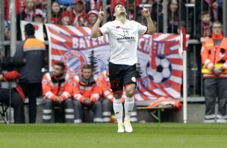 Mainz's Bojan celebrates after scoring his side's opening goal during the German Bundesliga soccer match between FC Bayern Munich and FSV Mainz 05 at the Allianz Arena stadium in Munich, Germany, Saturday, April 22, 2017. (AP Photo/Matthias Schrader)