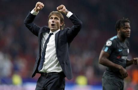 Chelsea coach Antonio Conte celebrates after a Champions League group C soccer match between Atletico Madrid and Chelsea at the Wanda Metropolitano stadium in Madrid, Spain, Wednesday, Sept. 27, 2017. Chelsea defeated Atletico by 2-1. (AP Photo/Francisco Seco)