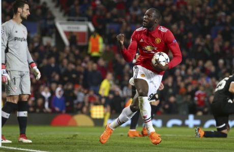 Manchester United's Romelu Lukaku celebrates towards the crowd after he scored his sides first goal of the game during the Champions League round of 16 second leg soccer match between Manchester United and Sevilla, at Old Trafford in Manchester, England, Tuesday, March 13, 2018. (AP Photo/Dave Thompson)