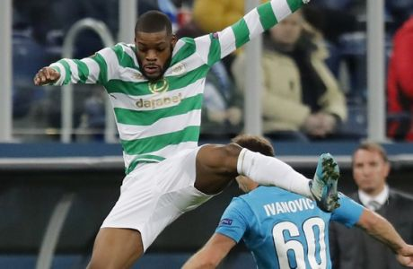 Celtic's Olivier Ntcham, left, competes for the ball with Zenit's Branislav Ivanovic during the Europa League round of 32 second leg soccer match between Zenit St. Petersburg and Celtic at the Saint Petersburg stadium, in St. Petersburg, Russia, Thursday, Feb. 22, 2018. (AP Photo/Pavel Golovkin)