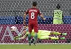Chile goalkeeper Claudio Bravo stops a penalty from Portugal's Joao Moutinho during the Confederations Cup, semifinal soccer match between Portugal and Chile, at the Kazan Arena, Russia, Wednesday, June 28, 2017. (AP Photo/Ivan Sekretarev)