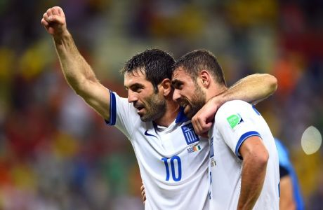 FORTALEZA, BRAZIL - JUNE 24:  Giorgos Karagounis (L) and Giannis Maniatis of Greece celebrate after defeating the Ivory Coast 2-1 during the 2014 FIFA World Cup Brazil Group C match between Greece and the Ivory Coast at Castelao on June 24, 2014 in Fortaleza, Brazil.  (Photo by Laurence Griffiths/Getty Images)