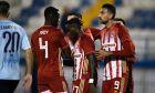 Ο Αχμέντ Χασάν του Ολυμπιακού πανηγυρίζει γκολ που σημείωσε κόντρα στον Απόλλωνα για τη Super League Interwetten 2020-2021 στο 'Γεώργιος Καμάρας' | Κυριακή 31 Ιανουαρίου 2021