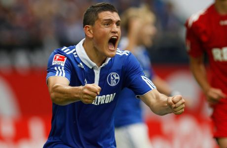 Schalke 04's Kyriakos Papadopoulos reacts during their German first division Bundesliga soccer match against Cologne in Gelsenkirchen, August 13, 2011. REUTERS/Ina Fassbender (GERMANY - Tags: SPORT SOCCER)  DFL LIMITS USE OF IMAGES ON THE INTERNET TO 15 PICTURES DURING THE MATCH AND PROHIBITS MOBILE (MMS) USE DURING AND UP TO 2 HOURS POST MATCH. FOR MORE INFORMATION CONTACT DFL