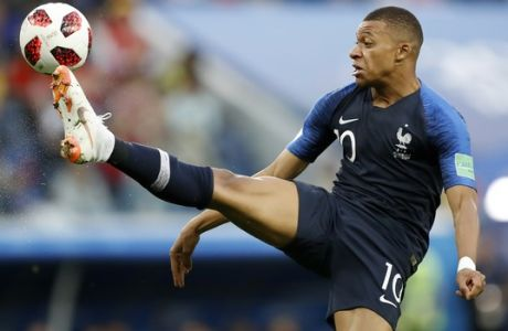 France's Kylian Mbappe controls the ball during the semifinal match between France and Belgium at the 2018 soccer World Cup in the St. Petersburg Stadium, in St. Petersburg, Russia, Tuesday, July 10, 2018. (AP Photo/David Vincent)