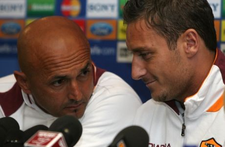 Roma's Francesco Totti, right, sits with his manager Luciano Spaletti at a press conference at Old Trafford Stadium the day before his team's Champion's League quarterfinal second leg soccer match against Manchester United, in Manchester, England, Tuesday April 9, 2007. (AP Photo/Jon Super)