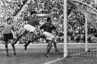 Italian goalkeeper Carlo Mattel, left and Italian defenders Francesco Janich, centre, and Sandro Dalvadore, are all beaten as the ball flashes into the net to give Chile their first goal during the Football World Cup match at Santiago, on June 2, 1962. Chile won the match by two goals to nil. (AP Photo)