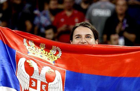Serbian Prime Minister Ana Brnabic poses with Serbian flag after Slovenia winning the Eurobasket European Basketball Championship final match against Serbia, in Istanbul, Sunday, Sept. 17. 2017. (AP Photo/Lefteris Pitarakis)