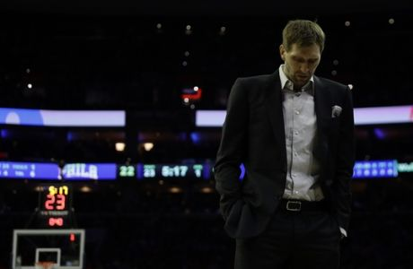 Dallas Mavericks' Dirk Nowitzki walks the court during a timeout in an NBA basketball game against the Philadelphia 76ers, Saturday, Jan. 5, 2019, in Philadelphia. (AP Photo/Matt Slocum)