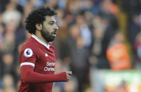 Liverpool's Mohamed Salah during the English Premier League soccer match between Liverpool and West Ham United at Anfield in Liverpool, England, Saturday, Feb. 24, 2018. (AP Photo/Rui Vieira)