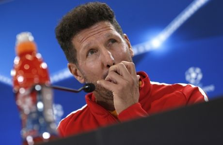 Atletico Madrid's head coach Diego Simeone listens to a question during a news conference at the Metropolitano stadium in Madrid, Tuesday, Sept. 26, 2017. Atletico Madrid will play a Champions League Group C soccer match with Chelsea on Wednesday. (AP Photo/Francisco Seco)