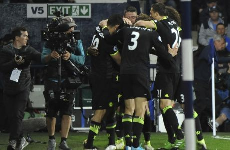Chelsea's player celebrate the goal of Chelsea's Michy Batshuayi during the English Premier League soccer match between West Bromwich Albion and Chelsea, at the Hawthorns in West Bromwich, England, Friday, May 12, 2017. (AP Photo/Rui Vieira)