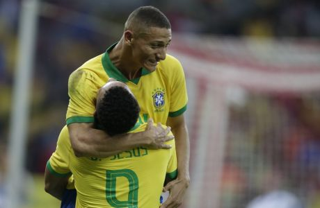 Brazil's Gabriel Jesus, bottom, celebrates scoring his side's 4th goal with Brazil's Richarlison during a friendly soccer match against Honduras at the Beira Rio stadium in Porto Alegre, Brazil, Sunday, June 9, 2019. Brazil opens the Copa America tournament next Friday against Bolivia in Sao Paulo. (AP Photo/Edison Vara)