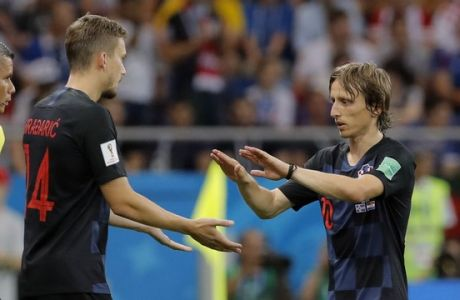 Croatia's Luka Modric, right, leaves the field during the group D match between Iceland and Croatia, at the 2018 soccer World Cup in the Rostov Arena in Rostov-on-Don, Russia, Tuesday, June 26, 2018. (AP Photo/Vadim Ghirda)