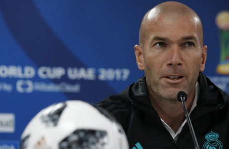 Real Madrid's head coach Zinedine Zidane speaks during a press conference at Zayed sport city in Abu Dhabi, United Arab Emirates, Friday, Dec. 15, 2017. Real Madrid will play against Gremio on Saturday in the Club World Cup final soccer match. (AP Photo/Hassan Ammar)