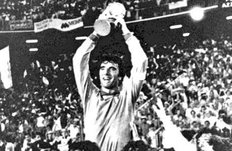 FILE - In this July 11, 1982 file photo, Italian team captain and goalkeeper Dino Zoff, is raised aloft by his teammates while holding the World Cup in the Santiago Bernabeu Stadium, in Madrid, after Italy defeated West Germany 3-1 in the World Cup final soccer match. On this day: After a 44 year interval Italy finally wins its third World Cup.  (AP Photo/File)