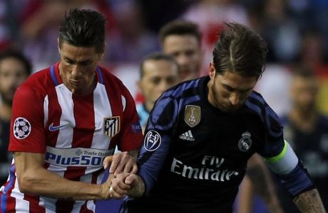 Atletico's Fernando Torres, left, and Real Madrid's Sergio Ramos battle for the ball during a Champions League semifinal, 2nd leg soccer match between Atletico de Madrid and Real Madrid, in Madrid, Spain, Wednesday, May 10, 2017 . (AP Photo/Daniel Ochoa de Olza)