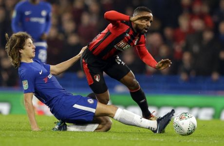 Chelsea's Ethan Ampadu, left, tackles Bournemouth's Jermain Defoe during the English League Cup quarterfinal soccer match between Chelsea and Bournemouth at Stamford Bridge stadium in London, Wednesday, Dec. 20, 2017. (AP Photo/Alastair Grant)