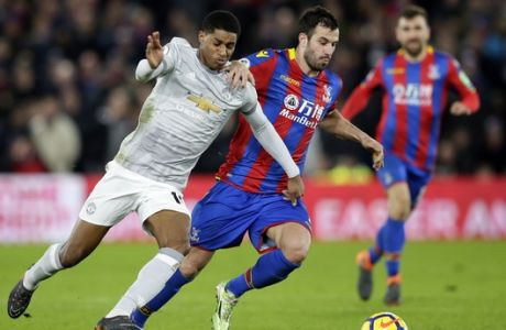 Manchester United's Marcus Rashford, left, competes for the ball with Crystal Palace's Luka Milivojevic during the English Premier League soccer match between Crystal Palace and Manchester United at Selhurst Park in London, Monday, March 5, 2018. (AP Photo/Tim Ireland)