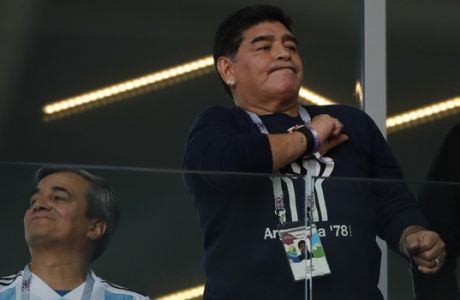 Former soccer star Diego Maradona pounds his chest during the group D match between Argentina and Iceland at the 2018 soccer World Cup in the Spartak Stadium in Moscow, Russia, Saturday, June 16, 2018. (AP Photo/Ricardo Mazalan)