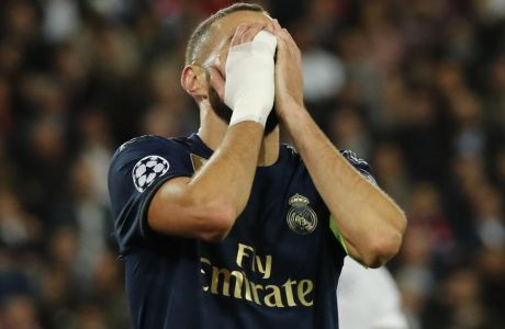 Real Madrid's Karim Benzema reacts after a missed scoring opportunity during the Champions League group A soccer match between PSG and Real Madrid at the Parc des Princes stadium in Paris, Wednesday, Sept. 18, 2019. (AP Photo/Francois Mori)