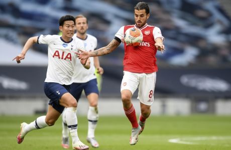 Arsenal's Dani Ceballos controls the ball next to Tottenham's Son Heung-min, left, during the English Premier League soccer match between Tottenham Hotspur and Arsenal at the Tottenham Hotspur Stadium in London, England, Sunday, July 12, 2020. (Michael Regan/Pool via AP)
