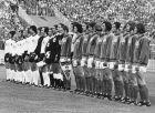 The teams from West Germany, in white shirts, and East Germany line up for the national anthems before the start of the Football World Cup Group 1 match at the Volksparkstadion, in Hamburg, on June 22, 1974. The match ended in a 1 - 0 win for East Germany. From left to right West German team; Uli Hoeness, Paul Breitner, Berti Vogts, Jurgen Grabowski, Wolfgang Overath, Gerd Muller, Heinz Flohe, Hans-Georg Schwrzenbeck, Berhard Cullmann, goalkeeper Sepp Maier and captain Franz Beckenbauer. Referee Ramon Barreto of Uruguay stands between his two linesmen. East German team from left to right; Captain Bernd Bransch, goalkeeper Jurgen Croy, Jurgen Sparwasser, Hans-Jurgen Kreische, Harald Irmscher, Gerd Kische, Lothar Kurbjuweit, Reinard Lauck, Siegmar Watzlich, Konrad Weise and Martin Hoffmann. (AP Photo)