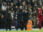 Manchester City's manager Pep Guardiola, centre applauds his players during their English Premier League soccer match between Manchester City and Liverpool at the Ethiad stadium, Manchester England, Thursday, Jan. 3, 2019. (AP Photo/Jon Super)