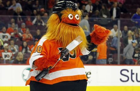 The Philadelphia Flyers mascot, Gritty, takes to the ice during the first intermission of the Flyers' preseason NHL hockey game against the Boston Bruins, Monday, Sept, 24, 2018, in Philadelphia. (AP Photo/Tom Mihalek)