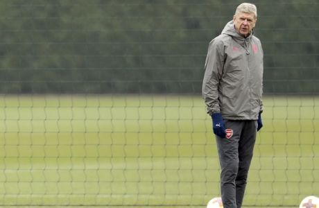 Arsenal manager Arsene Wenger attends a training session with his team at London Colney, Wednesday Feb. 21, 2018. (Adam Davy/PA via AP)