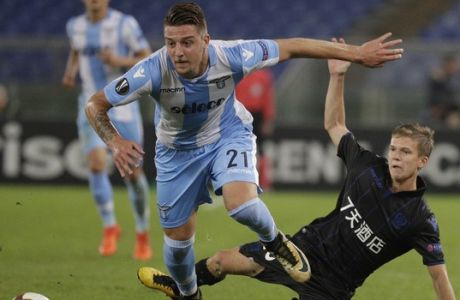 Lazio's Sergej Milinkovic-Savic and Nice's Vincent Koziello, right, vie for the ball during an Europa League group K soccer match between Lazio and Nice, at Rome's Olympic Stadium, Thursday, Nov. 2, 2017. (AP Photo/Andrew Medichini)