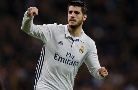 Real Madrid's Alvaro Morata celebrates after scoring the opening goal against Deportivo during a Spanish La Liga soccer match between Real Madrid and Deportivo Coruna at the Santiago Bernabeu stadium in Madrid, Saturday, Dec. 10, 2016. (AP Photo/Francisco Seco)
