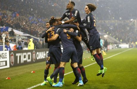 Paris Saint Germain' players celebrate after they scored a goal against Monaco during their League Cup final soccer match in Decines, near Lyon, central France, Saturday, April 1, 2017. (AP Photo/Laurent Cipriani)
