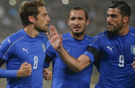 Italys Claudio Marchisio, left, celebrates with his teammate Graziano Pelle, right, and Giorgio Chiellini after scoring on a penalty kick during a friendly soccer match between Italy and Romania at the Renato Dall'Ara stadium in Bologna, Italy, Tuesday, Nov. 17, 2015. (AP Photo/Luca Bruno)